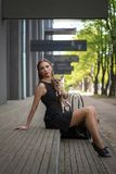 Young fashion woman, sitting with her dog on the stairs stock images