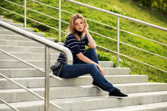 Young fashion woman sitting on the steps Royalty Free Stock Image
