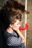 Young fashion woman sleeping. Young beautiful women in fashion cloths sleeping on the wooden branch stock image