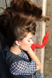 Young fashion woman sleeping. Young beautiful women in fashion cloths sleeping on the wooden branch royalty free stock photo