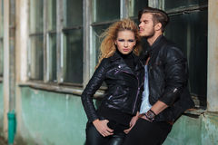 Young fashion woman standing near her lover Royalty Free Stock Photos