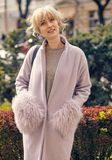Fashion woman on the street in a pink coat. Young fashion woman on the street in a pink coat Stock Photo