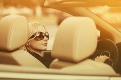 Young fashion woman driving convertible car royalty free stock image