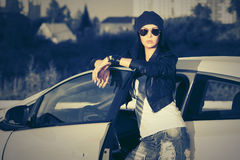 Young fashion woman in sunglasses standing next to her car Royalty Free Stock Photography