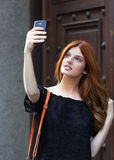 Young fashion woman taking a selfie. With smart phone Royalty Free Stock Image