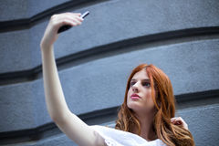 Young fashion woman taking a selfie. With smart phone Royalty Free Stock Photos