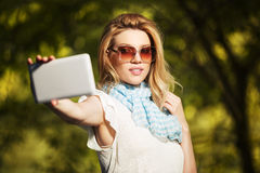 Young fashion woman taking selfie with tablet computer Royalty Free Stock Image