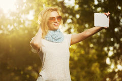 Young fashion woman taking a selfie with tablet computer Stock Image