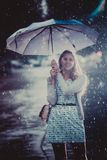 Young fashion woman with umbrella.  Filtered image with blurry rain Royalty Free Stock Image