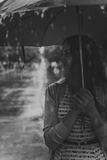 Young fashion woman with umbrella.  Filtered image with blurry rain Royalty Free Stock Photos