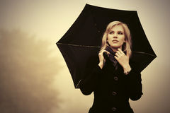 Young fashion woman with umbrella walking outdoor Royalty Free Stock Photos