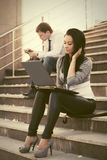 Young fashion woman using laptop on the steps Stock Images