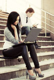 Young fashion woman using laptop on the steps Stock Photo