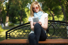 Young fashion woman using tablet computer outdoor Royalty Free Stock Images