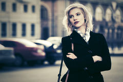 Young fashion woman walking on city street Royalty Free Stock Photo