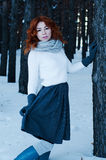 Young fashion woman in winter forest. Young fashion girl red head in winter forest Royalty Free Stock Photos