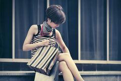 Free Young Fashion Woman With Shopping Bag Sitting On The Mall Steps Royalty Free Stock Photography - 181585537