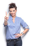 Young fashion womanhowing the victory sign Stock Image
