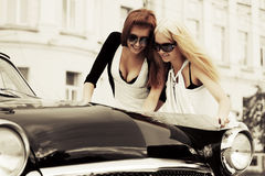 Young fashion women with a road map by retro car Stock Photography