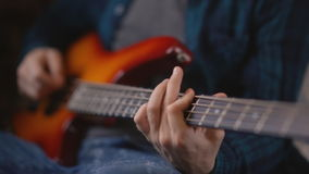 Young fashionable Bearded hipster playing guitar playing melody bass guitar stock video footage
