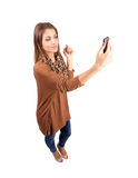 Young fashionable beauty taking selfie with mobile phone Stock Photography