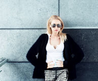 Young fashionable blonde girl posing. Royalty Free Stock Image