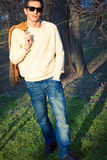 Young fashionable boy walks in the park Stock Photo