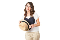 Young fashionable brunette with a stylish hat. Isolated on white Royalty Free Stock Photos