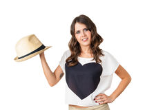 Young fashionable brunette with a stylish hat. Young fashionable brunette spinning a stylish hat isolated on white Stock Photography