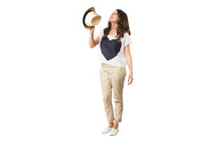 Young fashionable brunette throwing a hat. Young fashionable brunette throwing a stylish hat isolated on white Stock Image