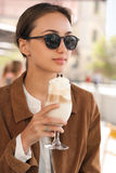 Young fashionable brunette woman having fun in the city. Stock Photography