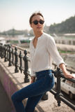 Young fashionable brunette woman having fun in the city. Royalty Free Stock Photo