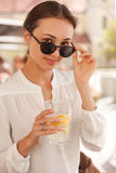 Young fashionable brunette woman having fun in the city. Royalty Free Stock Photos
