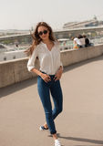 Young fashionable brunette woman having fun in the city. Royalty Free Stock Photography