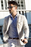 Young fashionable businessman walking to work Stock Image