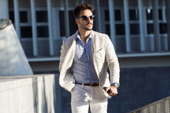 Young fashionable businessman walking to work Stock Photography