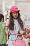 Young fashionable Chinese girl with a pink hat, Beijing, China royalty free stock image