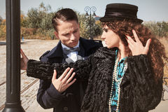 Young fashionable couple alongside a railway line beside street Royalty Free Stock Photos