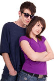 Young fashionable couple posing Royalty Free Stock Photos