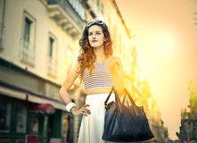 Young fashionable girl doing shopping Royalty Free Stock Photography