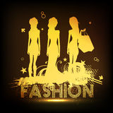 Young fashionable girls with shopping bags. Stock Photography