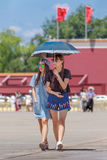 Young fashionable girls on a sunny Tiananmen Square, Beijing, China stock images
