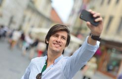 Young fashionable hipster Hispanic man with sunglasses taking a selfie Stock Images