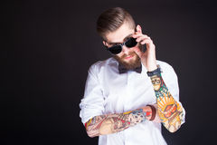 Young fashionable hipster man in white shirt Stock Photography
