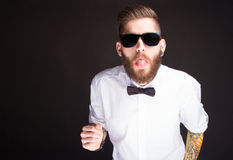 Young fashionable hipster man in white shirt Royalty Free Stock Photos