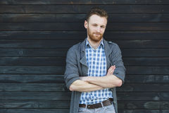 Young fashionable man against wooden wall Stock Images