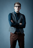 Young fashionable man in a shirt, vest and glasse Royalty Free Stock Images