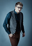 Young fashionable man in a shirt, vest and glasse Royalty Free Stock Photography