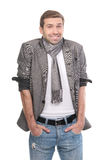 Young fashionable man wearing a scarf and gray clothes Stock Photography