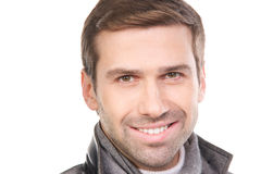 Young fashionable man wearing a scarf and gray clothes Stock Images